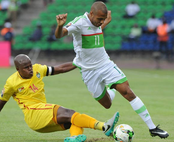 Willard Katsande of Zimbabwe tackles Yacine Brahim of Algeria during the Afcon Group B match between Algeria and Zimbabwe on the 15 January 2017 at Franceville Stadium, Gabon Pic Sydney Mahlangu/ BackpagePix