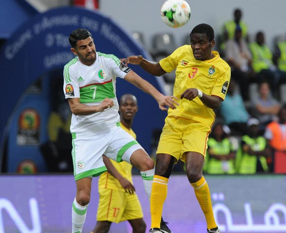 Riyad Karim Mahrez of Algeria challenges Danny Phiri of Zimbabwe during the Afcon Group B match between Algeria and Zimbabwe on the 15 January 2017 at Franceville Stadium, Gabon Pic Sydney Mahlangu/ BackpagePix