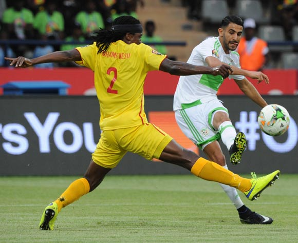 Riyad Karim Mahrez of Algeria is challenged by Costa Nhamoinesu of Zimbabwe during the Afcon Group B match between Algeria and Zimbabwe on the 15 January 2017 at Franceville Stadium, Gabon Pic Sydney Mahlangu/ BackpagePix