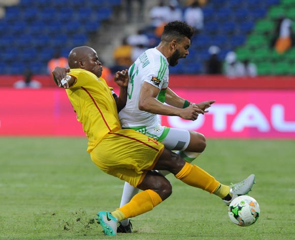 Willard Katsande of Zimbabwe tackles El Arabi Hilal Sudan of Algeria during the Afcon Group B match between Algeria and Zimbabwe on the 15 January 2017 at Franceville Stadium, Gabon Pic Sydney Mahlangu/ BackpagePix