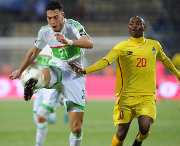 Amir Selmane Rami Bensebaini of Algeria is challenged by Khama Billiat of Zimbabwe during the Afcon Group B match between Algeria and Zimbabwe on the 15 January 2017 at Franceville Stadium, Gabon Pic Sydney Mahlangu/ BackpagePix