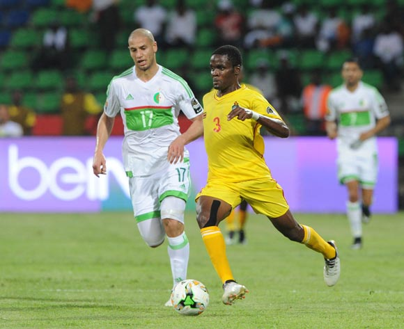 Danny Phiri of Zimbabwe is challenged by Adlane Guedioura of Algeria during the Afcon Group B match between Algeria and Zimbabwe on the 15 January 2017 at Franceville Stadium, Gabon Pic Sydney Mahlangu/ BackpagePix