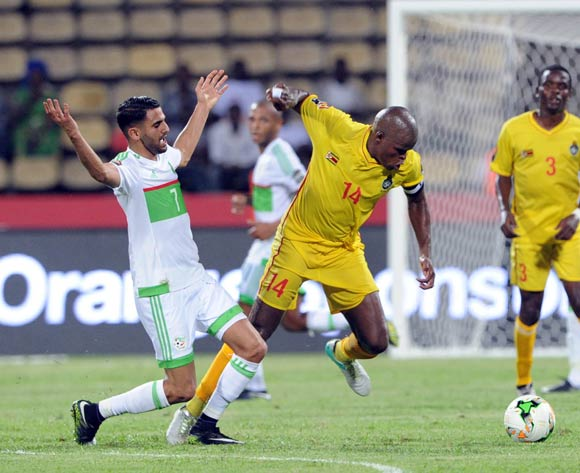Willard Katsande of Zimbabwe is challenged by Riyad Mahrez of Algeria during the Afcon Group B match between Algeria and Zimbabwe on the 15 January 2017 at Franceville Stadium, Gabon Pic Sydney Mahlangu/ BackpagePix