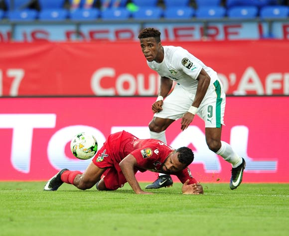 Jacques-Al Romao of Togo challenged by Wilfried Zaha of Ivory Coast during the 2017 Africa Cup of Nations Finals match between Ivory Coast and Togo at the Oyem Stadium in Gabon on 16 January 2017 ©Samuel Shivambu/BackpagePix