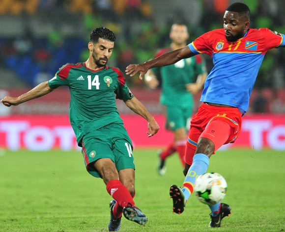 Mbark Boussoufa of Morocco challenged by Cedric Bakambu of DR Congo during the 2017 Africa Cup of Nations Finals match between DR Congo and Morocco at the Oyem Stadium in Gabon on 16 January 2017 ©Samuel Shivambu/BackpagePix