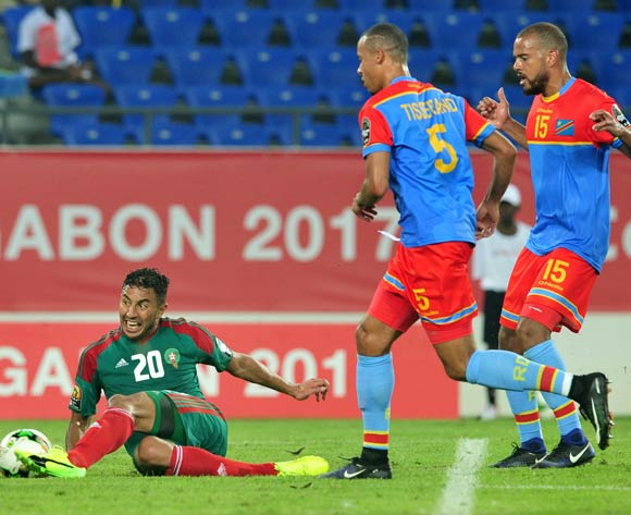 Aziz Bouhaddouz (l) of Morocco challenged by Marcel Tisserand (c) of DR Congo during the 2017 Africa Cup of Nations Finals match between DR Congo and Morocco at the Oyem Stadium in Gabon on 16 January 2017 ©Samuel Shivambu/BackpagePix