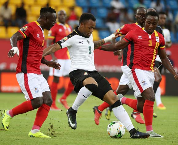 Tonny Mawejje of Uganda and Geofrey Kizito of Uganda (r) battles for the ball with Jordan Ayew of Ghana during the 2017 Africa Cup of Nations Finals football match between Ghana and Uganda at the Port Gentil Stadium in Gabon on 17 January 2017 ©Chris Ricco/BackpagePix