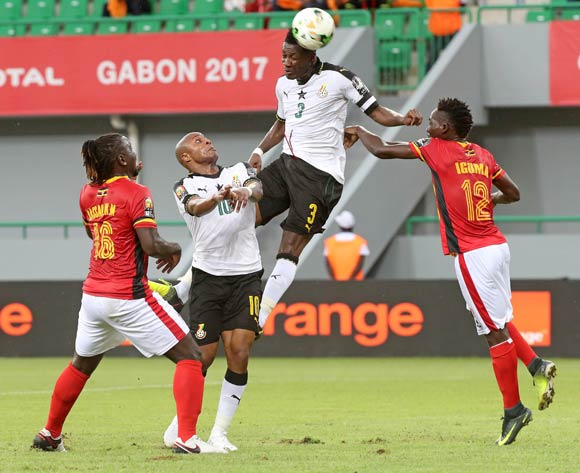 Asamoah Gyan of Ghana wins a header from Denis Iguma of Uganda as Hassan Wasswa of Uganda (l) and Andre Ayew (cl) of Ghana look on during the 2017 Africa Cup of Nations Finals football match between Ghana and Uganda at the Port Gentil Stadium in Gabon on 17 January 2017 ©Chris Ricco/BackpagePix
