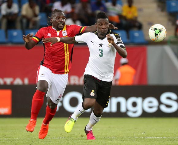 Asamoah Gyan of Ghana gets away from Hassan Wasswa of Uganda during the 2017 Africa Cup of Nations Finals football match between Ghana and Uganda at the Port Gentil Stadium in Gabon on 17 January 2017 ©Chris Ricco/BackpagePix