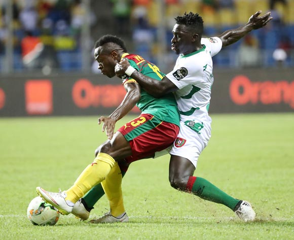 Christian Bassogog of Cameroon (l) tackled by Mamadu Cande of Guinea Bissau during the 2017 African Cup of Nations Finals Afcon football match between Cameroon and Guinea Bissau at the Libreville Stadium in Gabon on 18 January 2017 ©Gavin Barker/BackpagePix