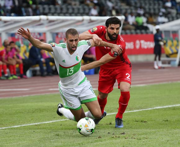 Islam Slimani of Algeria fouled by Syam Habib Youssef of Tunisia during the 2017 African Cup of Nations Finals Afcon football match between Algeria and Tunisia at the Franceville Stadium in Gabon on 19 January 2017 ©Gavin Barker/BackpagePix