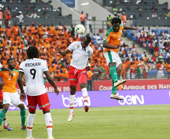 Wilfried Bony of Ivory Coast (r) heads in goal beats Merveille Bope of DR Congo in air during the 2017 African Cup of Nations Finals Afcon football match between Ivory Coast and DR Congo at the Oyem Stadium in Gabon on 20 January 2017 ©Gavin Barker/BackpagePix