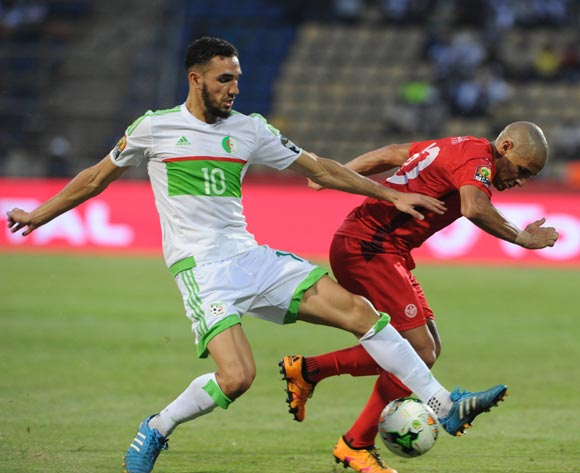 Nabil Bentaleb of Algeria tackles Wahbi Khazri of Tunisia during the Afcon Group B match between Algeria and Tunisia  on the 19 January 2017 at Franceville Stadium, Gabon Pic Sydney Mahlangu/ BackpagePix