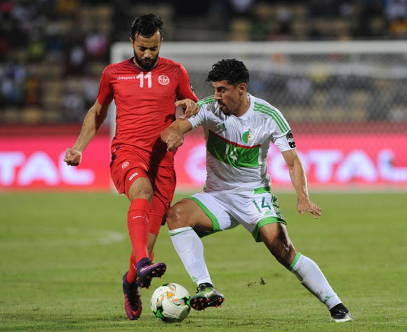 Baghdad Bounedjah of Algeria is challenged by Taha Khenissi of Tunisia during the Afcon Group B match between Algeria and Tunisia  on the 19 January 2017 at Franceville Stadium, Gabon Pic Sydney Mahlangu/ BackpagePix