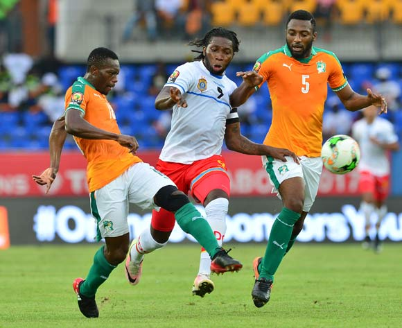 Dieudonne Bezua (c) of DR Congo challenged by Adama Traore (l) and Serge Kanon (r) of Ivory Coast during the 2017 Africa Cup of Nations Finals match between Ivory Coast and DR Congo at the Oyem Stadium in Gabon on 20 January 2017 ©Samuel Shivambu/BackpagePix