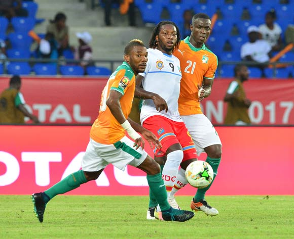 Dieudonne Bezua of DR Congo challenged by Die Serey and Eric Bailly of Ivory Coast during the 2017 Africa Cup of Nations Finals match between Ivory Coast and DR Congo at the Oyem Stadium in Gabon on 20 January 2017 ©Samuel Shivambu/BackpagePix
