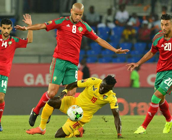 Lalawele Atakora of Togo challenged by Mbark Boussoufa, (l) Karim Aroussi El Ahmadi, (c) and Aziz Bouhaddouz of Morocco during the 2017 Africa Cup of Nations Finals match between Morocco and Togo at the Oyem Stadium in Gabon on 20 January 2017 ©Samuel Shivambu/BackpagePix