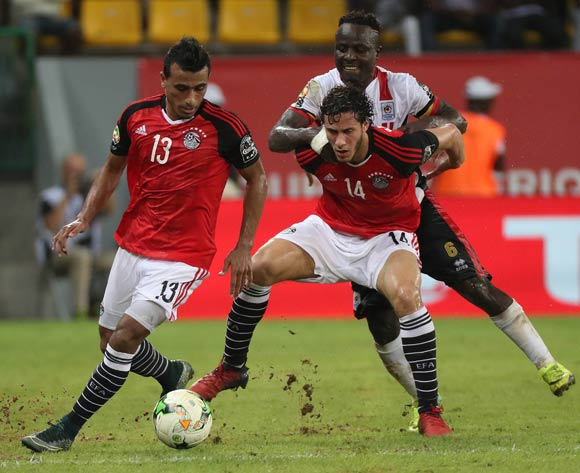 Mohamed Abdelshafi of Egypt (l) and Ramadan Sobhi of Egypt (c) battles for the ball with Tonny Mawejje of Uganda during the 2017 Africa Cup of Nations Finals football match between Egypt and Uganda at the Port Gentil Stadium in Gabon on 21 January 2017 ©Chris Ricco/BackpagePix