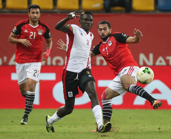 Benson Ochaya of Uganda tackled by Ahmed Fathi of Egypt during the 2017 Africa Cup of Nations Finals football match between Egypt and Uganda at the Port Gentil Stadium in Gabon on 21 January 2017 ©Chris Ricco/BackpagePix