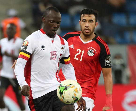Godfrey Walusimbi of Uganda evades challenge from Mahmoud Hassan of Egypt during the 2017 Africa Cup of Nations Finals football match between Egypt and Uganda at the Port Gentil Stadium in Gabon on 21 January 2017 ©Chris Ricco/BackpagePix