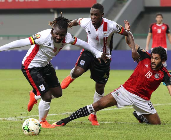 Marawan Mohsen of Egypt challenged by Murushid Juuko of Uganda (c) and Hassan Wasswa of Uganda (l) during the 2017 Africa Cup of Nations Finals football match between Egypt and Uganda at the Port Gentil Stadium in Gabon on 21 January 2017 ©Chris Ricco/BackpagePix