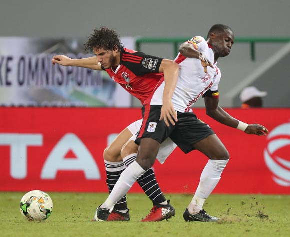Ramadan Sobhi of Egypt tackled by Faruku Miya of Uganda during the 2017 Africa Cup of Nations Finals football match between Egypt and Uganda at the Port Gentil Stadium in Gabon on 21 January 2017 ©Chris Ricco/BackpagePix