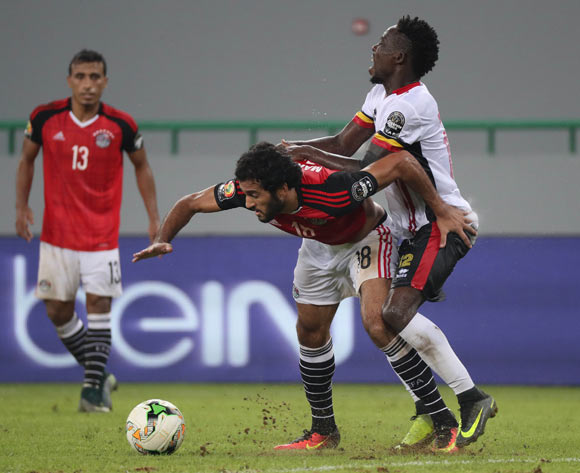 Marawan Mohsen of Egypt challenged by Denis Iguma of Uganda during the 2017 Africa Cup of Nations Finals football match between Egypt and Uganda at the Port Gentil Stadium in Gabon on 21 January 2017 ©Chris Ricco/BackpagePix