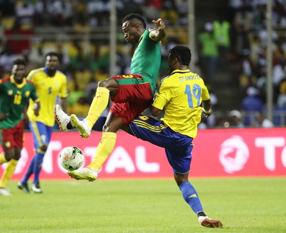 Christian Bassogog of Cameroon (l) tackled by Benjamin Ze Ondo of Gabon (r)  during the 2017 African Cup of Nations Finals Afcon football match between Cameroon and Gabon at the Libreville Stadium in Gabon on 22 January 2017 ©Gavin Barker/BackpagePix