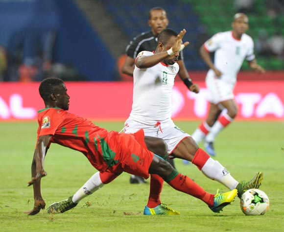 Tomas Dabo of Guinea Bissau tackles Abdou Traore of Burkina Faso during the Afcon Group A match between  Guinea Bissau and Burkina Faso  on the 22 January 2017 at Franceville , Gabon Pic Sydney Mahlangu/ BackpagePix