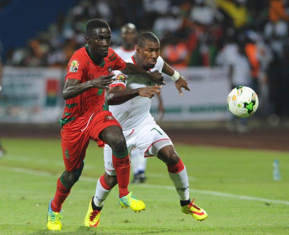 Tomas Dabo of Guinea Bissau challenges Niguime Nakoulma of Burkina Faso during the Afcon Group A match between  Guinea Bissau and Burkina Faso  on the 22 January 2017 at Franceville , Gabon Pic Sydney Mahlangu/ BackpagePix