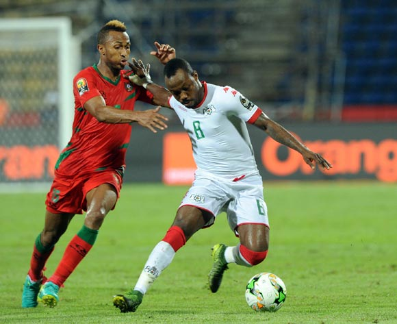 Brito E Silva Toni of Guinea Bissau challenges Abdou Traore of Burkina Faso during the Afcon Group A match between  Guinea Bissau and Burkina Faso  on the 22 January 2017 at Franceville , Gabon Pic Sydney Mahlangu/ BackpagePix