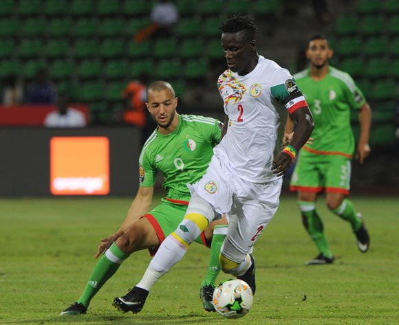 Serigne Mbodji of Senegal is challenged by Sofiane Hanni of Algeria during the Afcon Group B match between  Senegal and Algeria  on the 23 January 2017 at Franceville , Gabon Pic Sydney Mahlangu/ BackpagePix
