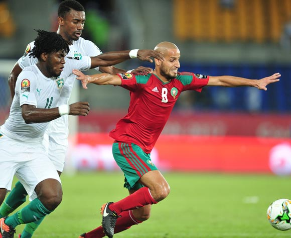 Karim Aroussi El Ahmadi (r) of Morocco challenged by Franck Nessie (l) and Salomon Kalou (c) of Ivory Coast during the 2017 Africa Cup of Nations Finals match between Morocco and Ivory Coast at the Oyem Stadium in Gabon on 24 January 2017 ©Samuel Shivambu/BackpagePix