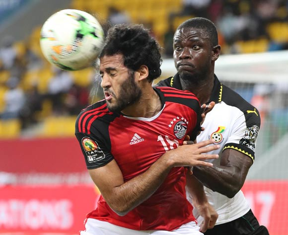 Marwan Mohsen of Egypt battles for the ball with Jonathan Mensah of Ghana during the 2017 Africa Cup of Nations Finals football match between Egypt and Ghana at the Port Gentil Stadium in Gabon on 25 January 2017 ©Chris Ricco/BackpagePix