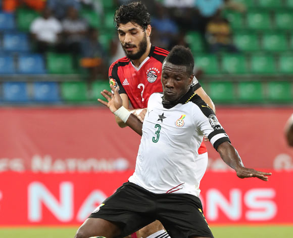 Asamoah Gyan of Ghana challenged by Ali Gabr of Egypt during the 2017 Africa Cup of Nations Finals football match between Egypt and Ghana at the Port Gentil Stadium in Gabon on 25 January 2017 ©Chris Ricco/BackpagePix