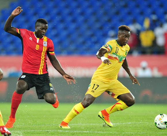 Mamoutou NDiaye of Mali challenged by Khalid Aucho of Uganda during the 2017 Africa Cup of Nations Finals match between Uganda and Mali at the Oyem Stadium in Gabon on 25 January 2017 ©Samuel Shivambu/BackpagePix