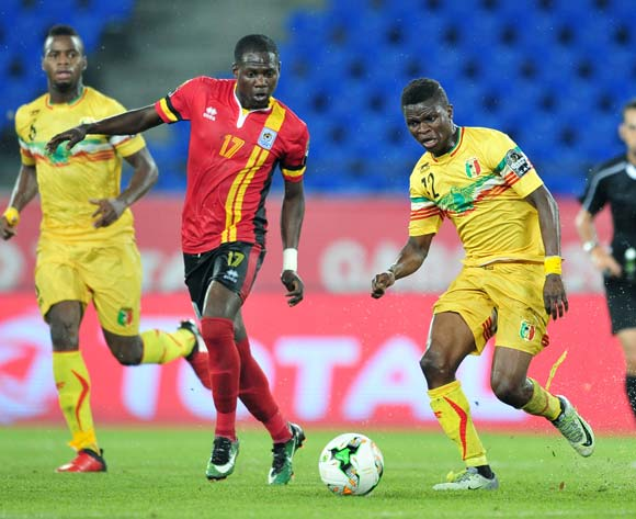 Moussa Doumbia of Mali challenged by Faruku Miya of Uganda during the 2017 Africa Cup of Nations Finals match between Uganda and Mali at the Oyem Stadium in Gabon on 25 January 2017 ©Samuel Shivambu/BackpagePix