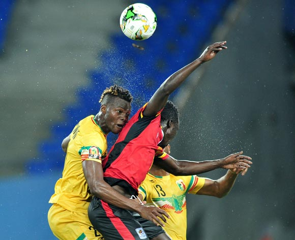 Luwaga Kizoto (c) of Uganda challenged by Mahamadou Ndiaye of Mali during the 2017 Africa Cup of Nations Finals match between Uganda and Mali at the Oyem Stadium in Gabon on 25 January 2017 ©Samuel Shivambu/BackpagePix