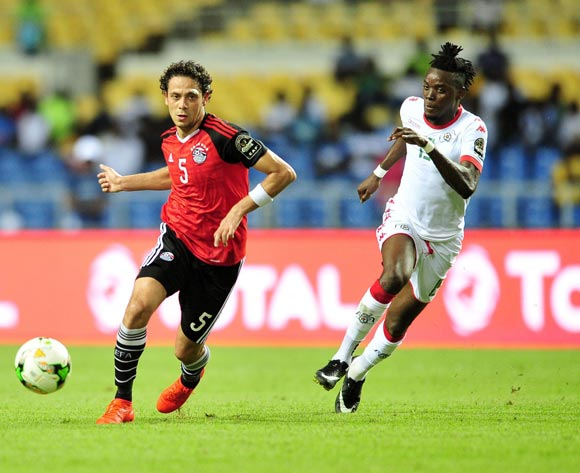Ibrahim Salah of Egypt (l) challenged by Bertrand Traore of Burkina Faso (r) during the 2017 Africa Cup of Nations semi final match between Burkina Faso and Egypt at the Libreville Stadium in Gabon on 01 February 2017.  EPA/Samuel Shivambu