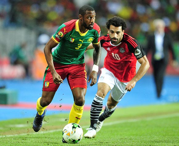 epa05773695 Nicolas Nkoulou of Cameroon challenged by Mohamed Salah of Egypt during the 2017 Africa Cup of Nations final match between Egypt and Cameroon at the Libreville in Gabon on 05 February 2017.  EPA/Samuel Shivambu