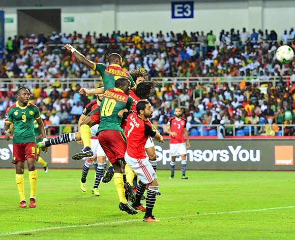 epa05773764 Nicolas Nkoulou (top) of Cameroon scores a goal during the 2017 Africa Cup of Nations final match between Egypt and Cameroon at the Libreville in Gabon on 05 February 2017.  EPA/Samuel Shivambu