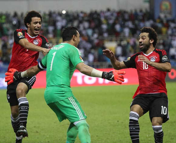 Essam El Hadary of Egypt  celebrates after saving Bertrand Traore of Burkina Faso penalty in shootout, embraced by Omar Gaber (l) and Mohamed Salah (r) during the 2017 African Cup of Nations Finals Afcon semifinal football match between Burkina Faso and Egypt at the Libreville Stadium in Gabon on 01 February 2017 ©Gavin Barker/BackpagePix