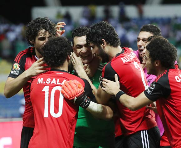 Essam El Hadary of Egypt celebrates after saving Bertrand Traore of Burkina Faso penalty in shootout, embraced by teammates during the 2017 African Cup of Nations Finals Afcon semifinal football match between Burkina Faso and Egypt at the Libreville Stadium in Gabon on 01 February 2017 ©Gavin Barker/BackpagePix