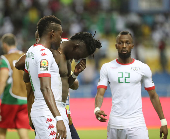 Bertrand Traore of Burkina Faso reacts in disappointment after missed penalty in shootout, consoled by teammate Alain Traore (l) penalty in shootout embraced by opposition coach Paulo Jorge Duarte during the 2017 African Cup of Nations Finals Afcon semifinal football match between Burkina Faso and Egypt at the Libreville Stadium in Gabon on 01 February 2017 ©Gavin Barker/BackpagePix