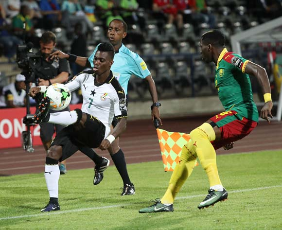 Christian Atsu of Ghana (l) challenged by Ambroise Oyongo of Cameroon during the 2017 Africa Cup of Nations Finals Afcon semifinal football match between Cameroon and Ghana at the Franceville Stadium in Gabon on 02 February 2017 ©Gavin Barker/BackpagePix