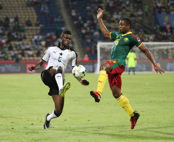 Thomas Partey of Ghana (l) challenged by Sebastien Siani of Cameroon (l) during the 2017 Africa Cup of Nations Finals Afcon semifinal football match between Cameroon and Ghana at the Franceville Stadium in Gabon on 02 February 2017 ©Gavin Barker/BackpagePix