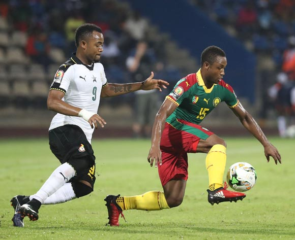 Sebastien Siani of Cameroon (r) shields ball from Jordan Ayew of Ghana (l) during the 2017 Africa Cup of Nations Finals Afcon semifinal football match between Cameroon and Ghana at the Franceville Stadium in Gabon on 02 February 2017 ©Gavin Barker/BackpagePix