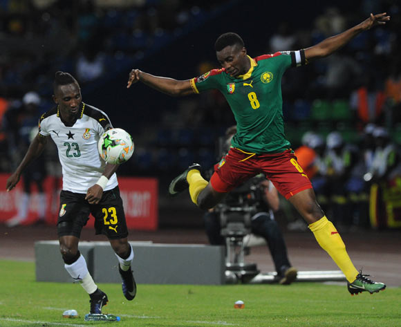 Harrison Afful of Ghana challenges Benjamin Moukandjo of Cameroon  during the 2017 Africa Cup of Nations Finals Afcon semifinal football match between Cameroon and Ghana at the Franceville Stadium in Gabon on 02 February 2017 ©Sydney Mahlangu/BackpagePix