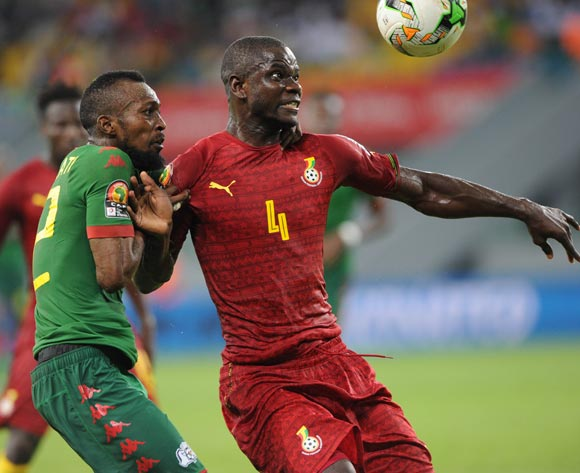 Jonathan Mensah of Ghana shields the ball away from Blati Toure of Burkina Faso during the 2017 Africa Cup of Nations Finals 3&4 match playoff between Burkina Faso and Ghana at the Port Gentil  in Gabon on 04 February 2017 ©Sydney Mahlangu/BackpagePix