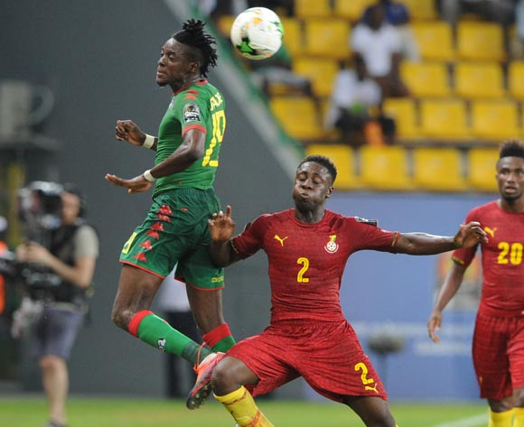 Bertrand Traore of Burkina Faso is challenged by Andrew Kyere Yiadom of Ghana during the 2017 Africa Cup of Nations Finals 3&4 match playoff between Burkina Faso and Ghana at the Port Gentil  in Gabon on 04 February 2017 ©Sydney Mahlangu/BackpagePix